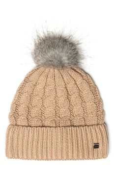 Chunky cotton-blend yarns offer breathable warmth in this cuffed beanie crowned with a faux fur pompom.