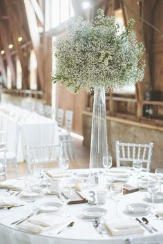 #babys-breath, #centerpiece Photography: Paper Antler - paperantler.com Read More: http://www.stylemepretty.com/midwest-weddings/2014/04/10/new-york-glamour-in-a-wisconsin-barn-wedding/
