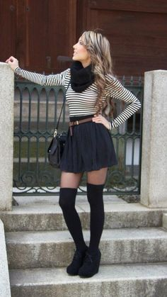 black and white thin striped long sleeve shirt, black infinity scarf, black high waisted skirt, black over the knee socks, and black suede lace up ankle wedges.