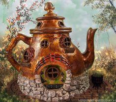 A miniature teapot fairy house to enchant your miniature fairy gardens.