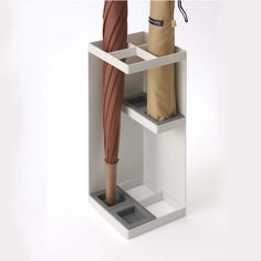 Space-savvy umbrella stand that can house both foldable and full-size umbrellas.