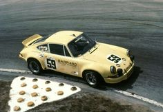 Going through the infamous Sebring Hairpin turn at the 1973 Sebring 12 Hours is the winning Porsche 911 Carrera RSR of Peter Gregg, Hurley Haywood and Dave Helmick.