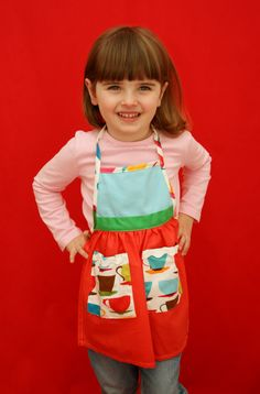 100% cotton fun and fashionable apron-frocks. Comes in a variety of inter-mixed fabrics with two pockets and exclusive of trim. Used for playtime, baking and cleaning. Makes any chore fun!