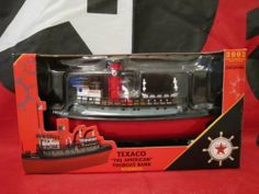 """2002 Texaco """"The American"""" Tugboat Bank Third in a Series by ERTL COLLECTIBLES. $29.95. BRAND NEW NEVER HAVING BEEN DISPLAYED OR PLAYED WITH,OR ANYTHING ELSE!. The Texaco """"American"""" tugboat was built in 1918 by the Texas S.S. Company and delivered to it's home port of Port Arthur,Texas in January of 1919.Equipped with two 500 pound anchors and an 18 person lifeboat,this 168 ton tug boasted an average speed of 10.5 knots and a steaming radius of nearly 1500 miles!And th..."""