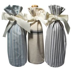 Bring chic country style to your next soiree with these charming wine bags, showcasing coordinating stripe motifs in blue and ribbon ties.  ...