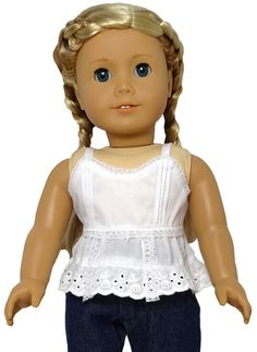 This darling white tank top will dress up any pair of jeans or skirt in your doll's wardrobe. The cotton top is detailed with lace trim and an eyelet flared hem. A Velcro closure at the back makes for easy dressing.