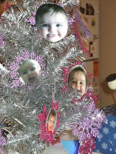 """Winter ONEderland - """"Elizabeth's tree"""" - a silver tree with pink and purple snowflake ornaments with Elizabeth's face! It was on our winter island with the cake pops - elevate with a box under the blanket of 'snow'"""