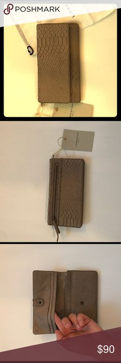 Liebeskind hand cut python tan wallet! Liebeskind hand cut cow leather - in tan python- wallet! NWT. Includes original duster bag as well :) Say hello yo your new favorite wallet for fall. Liebeskind Bags Wallets