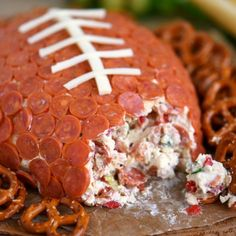 This Pepperoni Pizza Football Cheese Ball appetizer is both easy to make and a total showstopper! Make this next game day and wow the fans!