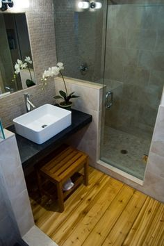 Asian 3/4 Bathroom with Soapstone counters, Kraus Vessel Sink in White with Sheven Faucet in Chrome, Pental black soapstone