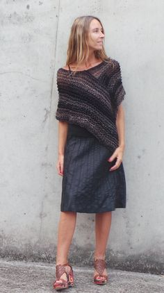 Hey, I found this really awesome Etsy listing at https://www.etsy.com/listing/205541386/brown-and-black-poncho-loose-knit-poncho