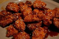 Chicken strips that taste just like those at the popular restaurant chain named after a day in the week. The sauce takes a while to cook, but can be made a day ahead and just rewarmed when you need it. They're tasty and flavorful. And perfect appetizers for your next party or game day! Enjoy.