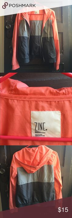 Zine windbreaker Lightweight windbreaker from Zumies. Minimal wear. Some threads around the hood showing on the interior but the garment itself isn't coming apart at all. Adorable tangerine with gray color block! It's pretty small, I can vary between small and medium and this is just uncomfortable small on me, sadly. Zine Clothing Jackets & Coats