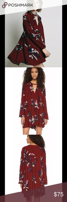 Free People Floral Tree Swing Tunic Dress Scarlet $148 Free People Floral Tree Swing Tunic Dress Scarlet Red Combo Sz XS  A breezy Free People top in a relaxed fit. A pretty floral print and embroidery on the sleeves add feminine touches. A front keyhole is secured with a single button at the neckline. Long sleeves. Fabric: Crepe. 100% rayon. Wash cold or dry clean. Imported, China. Free People Dresses