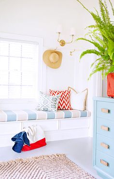 Home Tour: Traditional With a Fresh Modern Twist //  traditional, blue striped upholstered bench, blue dresser, colorful throw pillow, fern
