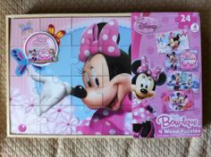 Bowtique Wood Puzzle, 4 Pack Box by Disney. $14.98. 4 different Puzzles with 24 pieces each. Wood Pieces are stonger for younger puzzle makers. Features popular characters. From the Manufacturer                Calling all Minnie fans. A great quality wooden puzzle, a fun way to be intrduced to the fun world of puzzles. Puzzles come stored in their very own carrying case.                                    Product Description                Minnie Mouse fans wil...
