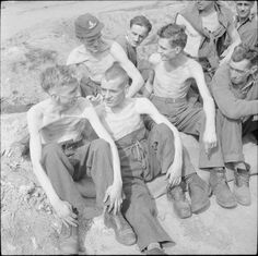 """Emaciated Allied POWs from Stalag XI-B are photographed shortly after their liberation by British troops of """"B"""" Squadron, Hussars (Prince Albert's Own) Army calvary regiment and the Reconnaissance Troop of the King's Royal Irish Hussars. World History, World War Ii, Battle Of Crete, Man Of War, American Veterans, Prisoners Of War, Historical Pictures, God Bless America, British Army"""