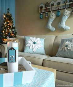 Love these Pale Blue Fabrics and Off White Poinsettia Pillows, Advent Candles, and Christmas Stockings in this sweet coastalChristmas corner.  Click through for a tutorial and details.