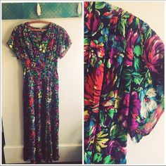 """Vintage 70's Bright Floral Maxi Dress This dress is absolutely gorgeous!! The colors are vibrant and the cut and style is perfect for a wedding this summer or just wearing to lunch with the girls. side zipper. Snap belt in back. Pleated detail in front and back. 34"""" chest 28"""" waist. Flutter sleeves. tiny spot on front see last picture looks like makeup. Barely noticeable among all the bright colors. But I don't have a dry cleaners here so you may want to have it cleaned. Otherwise gorgeous…"""
