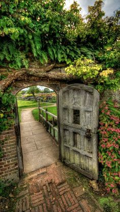 Perhaps the gate into the garden sets the standard for a Secret Garden? Through the garden gate at Barrington Court near Ilminster ~ Barrington Court, The Secret Garden, Secret Gardens, Garden Doors, Garden Entrance, Entrance Gates, Old Garden Gates, Modern Entrance, Fence Garden