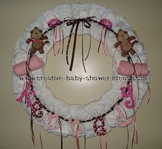 Diaper Wreath - going to make one for expecting sister-in-law for x-mas and jazz it up with ornaments and Christmasy things!