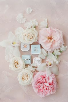 @tayloreventdesign did a lovely job filling the space with show-stopping pink and white blooms. View the full gallery on SMP.com for endless amounts of inspiration! 💗 | LBB Photography & Videography: @bonphotage #stylemepretty #weddingflatlay #weddingflowers #engagementring #prettywedding
