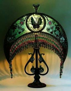 Art Nouveau and Art Deco Lampshades take the prize for intricate design.not as fussy as the Victorian lampshades, and more organic in shape. No mistake about the moon-shape.a moonlit room is romantic and relaxing.