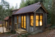 This rustic guest cabin features extensive custom interior woodwork. It has one bedroom and a sleeping loft in 714 sq ft.   www.facebook.com/SmallHouseBliss