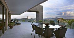 Mesa com tampo de vidro redondo