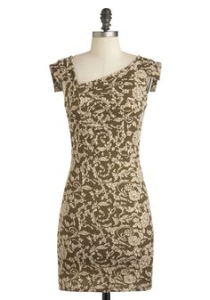 This olive-hued, body-hugging knit boasts a unique cut of an asymmetrical neckline, bold bodice ruching, and structured flap short sleeves, along with a stunning cream pattern of flowers and filigree. Pair this head-turning piece with strappy ankle boots, a sleek, slim belt, and a quilted, cross-body bag, for a look that's sure to capture your heart, as well as the attention of all who behold you!