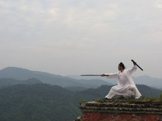 Master Chen Shiyu is performing Tai Chi Sword in the old site of  Temple of the Returning Dragon (Huilong Guan). wudangmartialarts.com