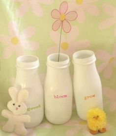 Starbucks frapachino glass bottles spray painted in white!  How cute!  They look like old milk bottles. by teri