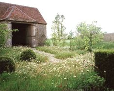 10 Ideas to Steal from English Cottage Gardens English cottage gardens are a charming (and practical) jumble of flowers, herbs, and fruit trees. See 10 design ideas to create an English cottage garden, from the editors of Gardenista. Meadow Garden, Dream Garden, Garden Shrubs, Garden Landscaping, Garden Beds, Shade Garden, Herb Garden, Fruit Garden, Landscaping Ideas
