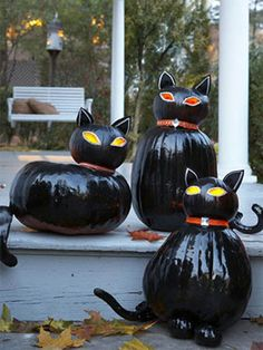 Black Cat Pumpkins. Carve just the eyes so they flicker at night.