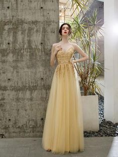 Golden evening dress v-neck party dress spaghetti straps prom dress tulle lace formal dress v-back party dress sold by shuiruyandresses. Shop more products from shuiruyandresses on Storenvy, the home of independent small businesses all over the world. Straps Prom Dresses, Backless Prom Dresses, Tulle Prom Dress, Lace Evening Dresses, Tulle Lace, Spaghetti Strap Dresses, Spaghetti Straps, Formal Dresses, Dance Dresses