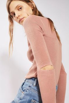 A trans-seasonal must, this dusty pink knitted top features a ribbed finish and spliced elbow detail. Style with your favourite high-waisted denim jeans.