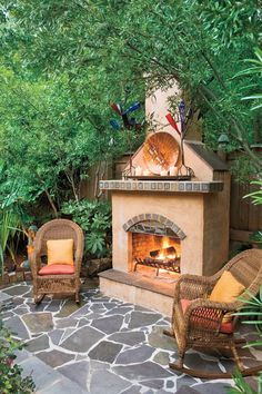 An outdoor fireplace, decorated with items that the homeowner acquired in his travels through the Southwest, dominates this sunken garden patio.