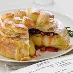 Dried cherries, toasted pecans, and honey top this brie round baked in puff pastry.