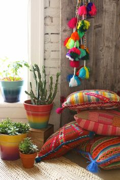 The hanging tassels... The boho cushions... The indoor plants. Delish!