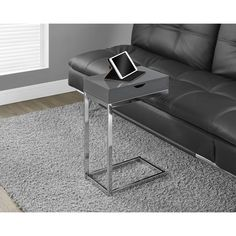Furnish your living room for style without compromising practical functionality with this gray accent table. Featuring a sleek form with the clean lines and crisp edges, this table boasts a spacious surface to hold your snacks, laptop or tablet.