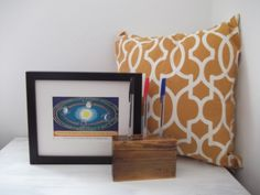 Modern Retro Style Space - Home Decor Box Set Harry & Co Homeware UK,A mixture of 1960's mustard coloured hand printed cushion, a 1963 framed print of planets rotating around the sun and a wood pen tidy for 3 pens/pencils. retro astronomy prints, retro sci fi, geometric cushion, geometric home decor uk, space station uk, moon prints, earth prints, planet prints, gifts for him, gifts for geeks, retro gift sets, subscription boxes, gift sets, gift boxes, pen tidy, wood home decor,