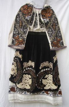 Bulgaria,Banat mountain region  Women  folk costume from Banat  mountain region, linen  shirt  and skirt with floral motives, sewed with silk, velvet apron, sewed with   silk and tinsel.