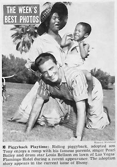 Pearl Bailey and her husband Louis Bellson play with their son Tony in this photograph for Jet Magazine's January 3, 1957 issue.