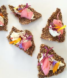 Red peppercorn fermented cashew cream cheese on flax crackers.  Pickled radish. Amaranth microgreens.  Flowers.