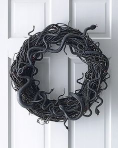 Greet your guests with a scare with this slithering snake wreath.  Source: Martha Stewart