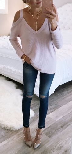 #winter #outfits white v-neck cold-shoulder shirt and distressed washed-blue skinny jeans