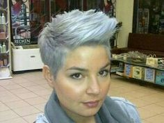 Funky flip silver and light blue tinted short hairstyle