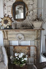 A salvaged mantle and a door are displayed on the porch of a country home - 52 FLEA