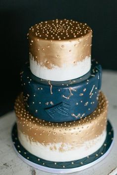 Constellation wedding cake | Stars to Guide Us Home: Wedding Inspiration Board | SouthBound Bride | http://www.southboundbride.com/inspiration-board-stars-to-guide-us-home | Credit: Meg Ruth Photo/Peridot Sweets via Green Wedding Shoes