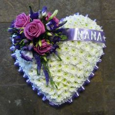 White based funeral Heart with a purple ribbon edge and a purple and pink floral spray of Roses, Veronica and Lisianthus. Florist London, Funeral Tributes, Same Day Flower Delivery, Purple Ribbon, Veronica, Roses, Seasons, Heart, Floral